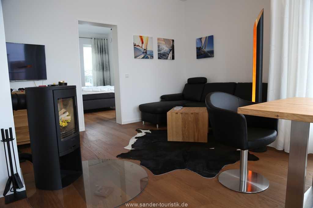 DünenResort - Gemütliche Sitzecke mit Holzkamin