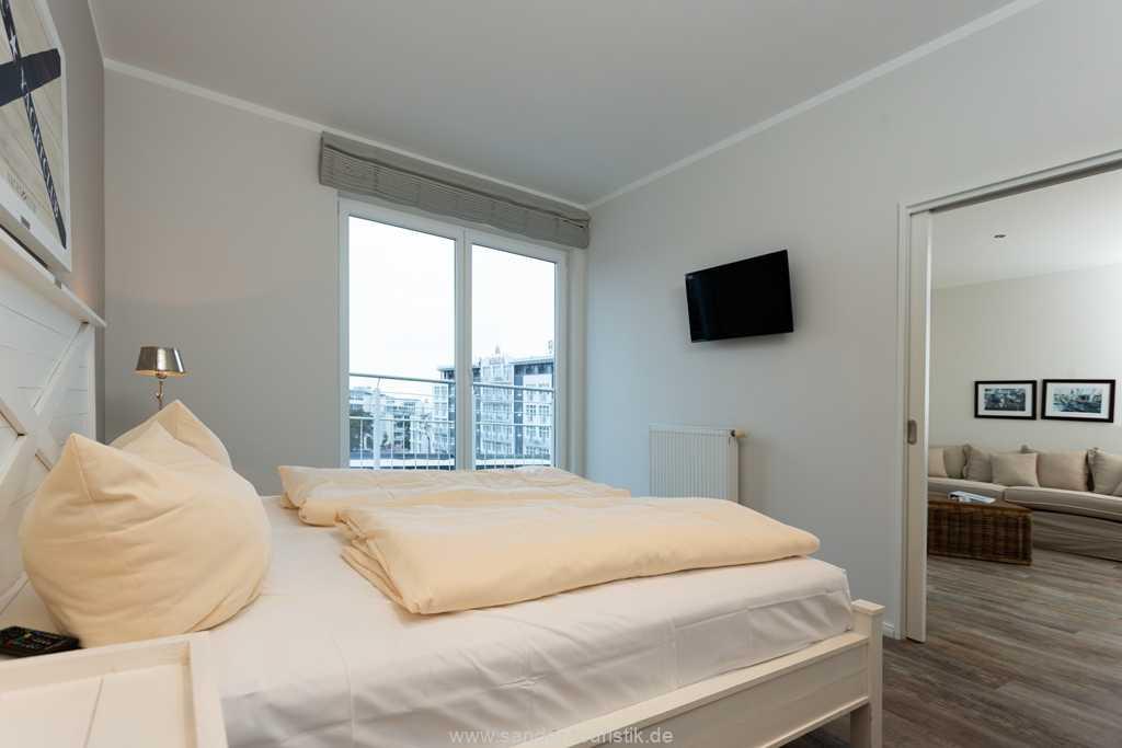 Foto der Wohnung RUG-20-301-50-belvital-binz-schlafzimmer-tv.jpg