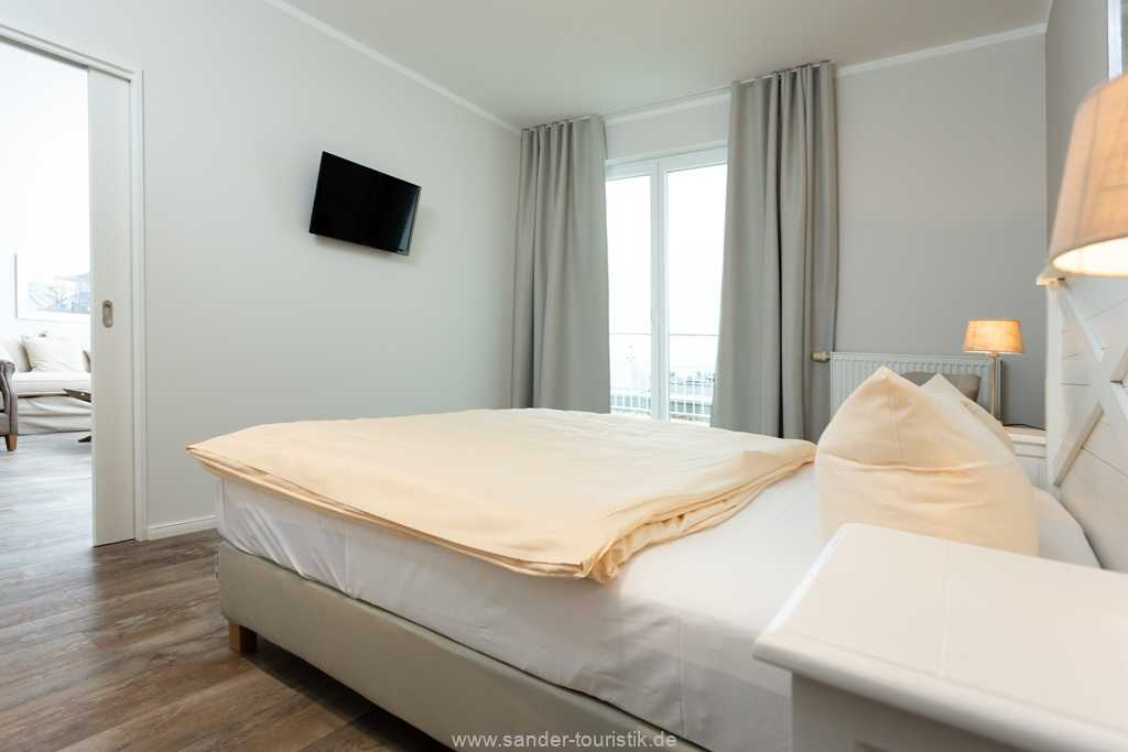Foto der Wohnung RUG-20-501-53-belvital-binz-schafzimmer-tv.jpg