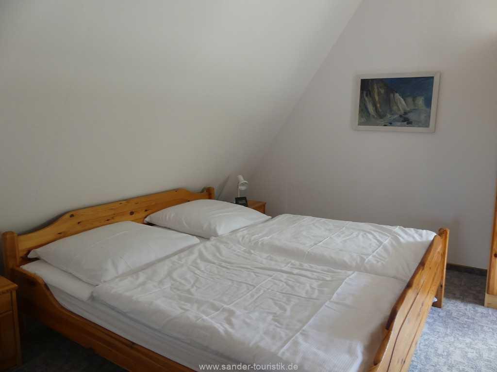Obergeschoss Ferienhaus, ein Schlafzimmer mit Doppelbett
