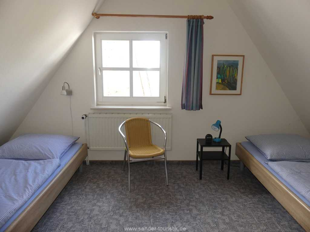 Obergeschoss Ferienhaus, 1 Schlafzimmer mit zwei Enzelbetten