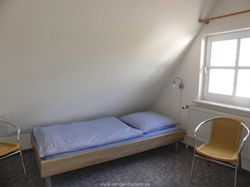 Zweibettzimmer im Ferienhaus mit TV
